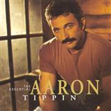 Download or print Aaron Tippin I Wonder How Far It Is Over You Sheet Music Printable PDF 5-page score for Country / arranged Piano, Vocal & Guitar (Right-Hand Melody) SKU: 123692.