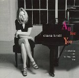 Download or print Diana Krall A Blossom Fell Sheet Music Printable PDF 6-page score for Jazz / arranged Piano, Vocal & Guitar SKU: 23070.