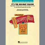 Download John Moss 'It's The Holiday Season - Eb Baritone Saxophone' Printable PDF 2-page score for Holiday / arranged Concert Band SKU: 288471.