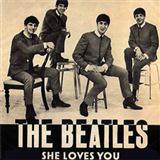Download or print The Beatles She Loves You Sheet Music Printable PDF 2-page score for Pop / arranged Guitar Ensemble SKU: 431858.